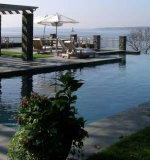 Vanishing edge pool with bluestone coping and apron.