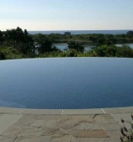 60' circular pool in the sky with vanishing edge.