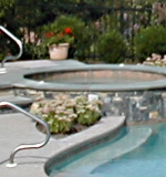 Detail of fully integrated spa with overflow into freeform pool.