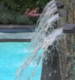 In classic Romanesque spouts, comes falling water.