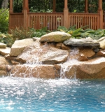 Small waterfall turns this freeform pool into a stunning focalpoint for the yard.
